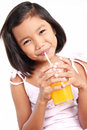 Girl with orange juice happy asian drinking an Royalty Free Stock Photo