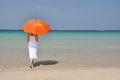 Girl with an orange umbrella Stock Photo