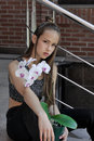 Girl with orchid flower is very sad. Royalty Free Stock Photo