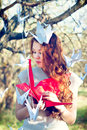 Girl with origami crane red Stock Images