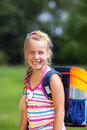 Girl outdoor park with school bag Stock Photography