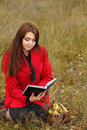 Girl outdoors read book Royalty Free Stock Images