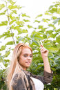 Girl outdoors touching a leaf Royalty Free Stock Photo