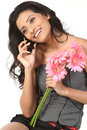 Girl over cellphone with pink daisy flowers Royalty Free Stock Photos