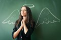 Girl over chalkboard with funny picture Royalty Free Stock Photography