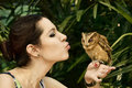 Girl with an owl pretty young kissing the bird in the national park pattaya thailand Royalty Free Stock Photos