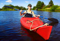 Girl with paddle and kayak 3 Royalty Free Stock Photo