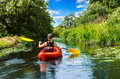 Girl with paddle and kayak  6 Royalty Free Stock Photo