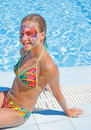 Girl with paint on his face in the pool Stock Photography
