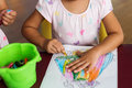 girl paint on paper by crayons Royalty Free Stock Photo
