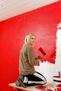 Girl with paint roller. Royalty Free Stock Image