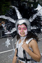 Girl with a painted face & a feathery headdress Royalty Free Stock Images