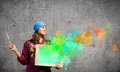 Girl painter young woman holding frame with colorful splashes Stock Photo