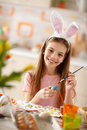 Girl painting blue egg for Easter Royalty Free Stock Photo