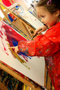 Girl painting with her finger Royalty Free Stock Photo