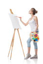 Girl paints on canvas with oil colors. Royalty Free Stock Photo