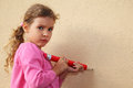 Girl paints by pencil on wall Royalty Free Stock Images