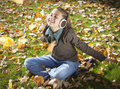 Girl in park with autumn leaves the beauty Stock Photography
