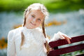 Girl on a park bench happy in spring garden Royalty Free Stock Image