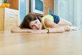 Girl on parquet floor at home Stock Photo