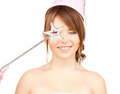 Girl in party cap with magic stick Royalty Free Stock Photo