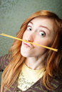 Girl with pasta mustache funny young woman spaghetti moustache Stock Photography