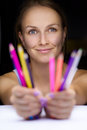 Girl with pencils beautiful holding a multicolored Stock Photography