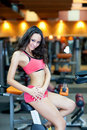 Girl with perfect body in fitness hall Royalty Free Stock Photography