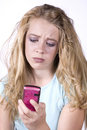 Girl with phone frustrated Stock Images