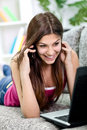 Girl with phone and laptop Stock Photo
