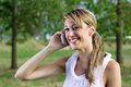 Girl on the phone portrait of a smiling woman talking Royalty Free Stock Photos