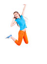 Girl phoning and jumping for joy white background Royalty Free Stock Photo