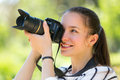 Girl with photocamera at park portrait of cheerful smiling Stock Photos
