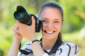 Girl with photocamera at park portrait of cheerful smiling young female Royalty Free Stock Images