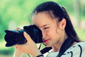 Girl with photocamera at park Royalty Free Stock Photo