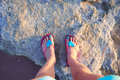 Girl photographed their feet on the shore of Lake Las Salinas. Torrevieja, Spain. Royalty Free Stock Photo