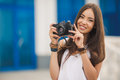 Girl photographer with professional SLR camera Royalty Free Stock Photo
