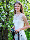 Girl photographs blossoming tree. Royalty Free Stock Photo