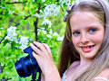 Girl photographs blossoming tree take picture cherry romantic style Royalty Free Stock Photo
