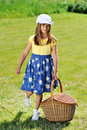Girl with picnic basket Royalty Free Stock Image