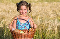 Girl with picnic basket little in cereals Royalty Free Stock Photos