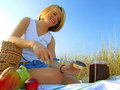 Girl with picnic breakfast Stock Images