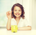 Girl with piggy bank picture of beautiful Royalty Free Stock Image