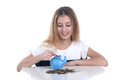 Girl with piggy bank teenage on white background Royalty Free Stock Photo