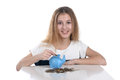 Girl with piggy bank teenage on white background Stock Photo