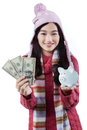 Girl with piggybank and dollar bills Royalty Free Stock Photo