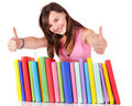 Girl with pile book showing thumb up. Stock Image