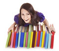 Girl with pile color book . Royalty Free Stock Photography