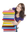 Girl with pile color book . Stock Photos