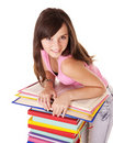 Girl with pile colored book . Stock Photos